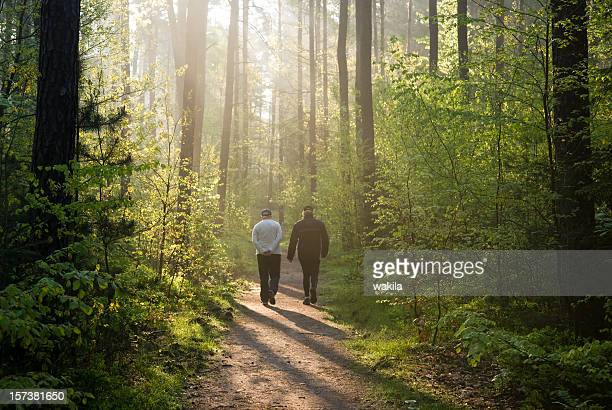 two people at Morning walk in forest