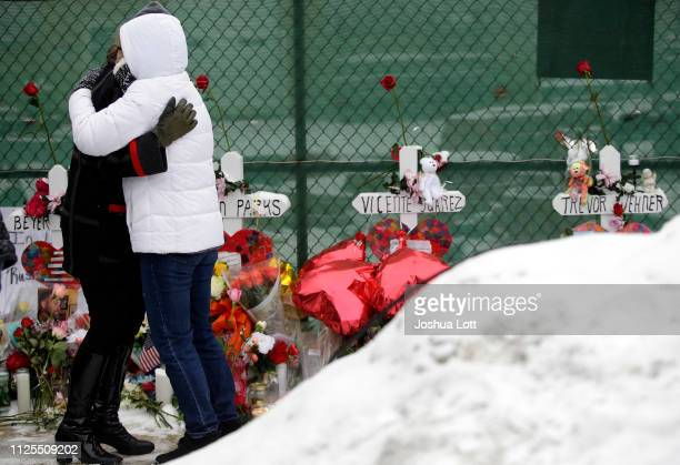 Two people attending a prayer vigil outside Henry Pratt Company embrace on February 17 2019 in Aurora Illinois Six people including a gunman were...
