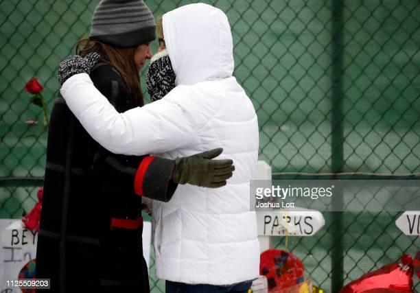 Two people attending a prayer vigil outside Henry Pratt Company embrace on February 17 2019 in Aurora Illinois Six people including a gunman were...