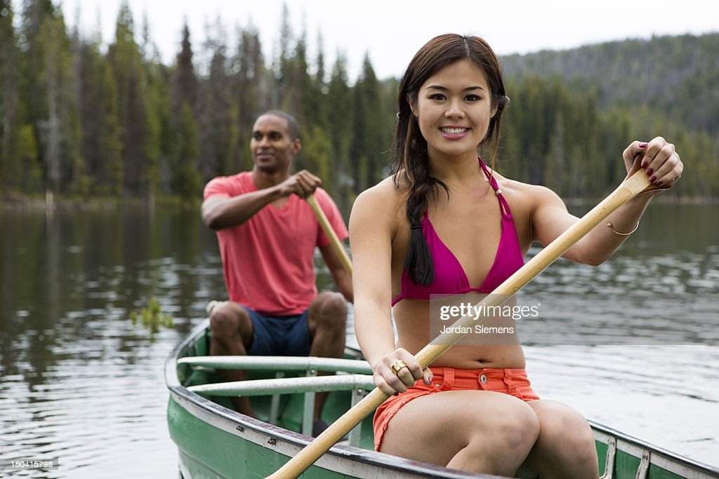 Two people canoeing on a lake. : Foto de stock
