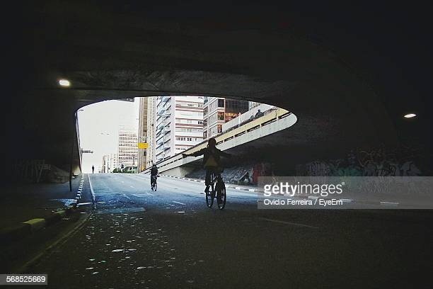 Two People Cycling On Road