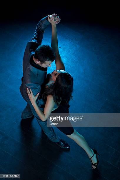 two people dancing a passionate tango - tango dance stock photos and pictures