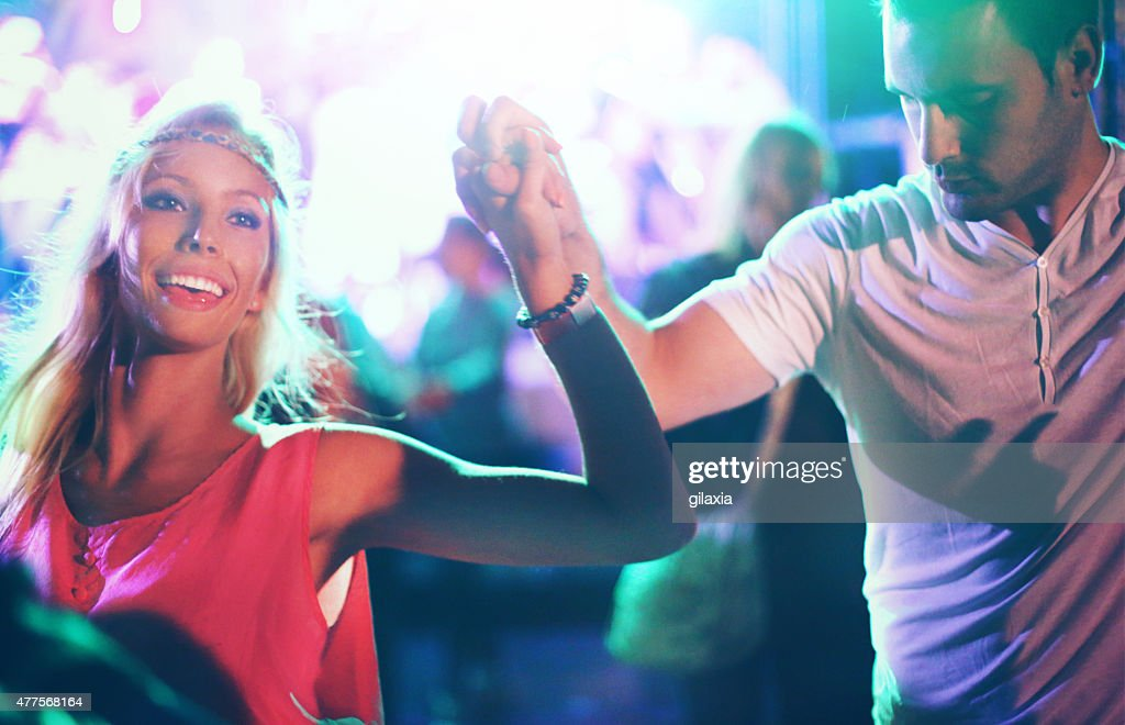 Two people dancing at concert. : Stock Photo