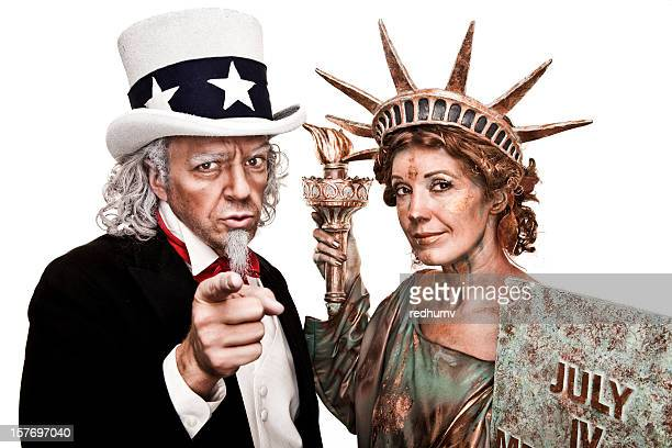 Two people dressed as Uncle Sam and Lady Liberty