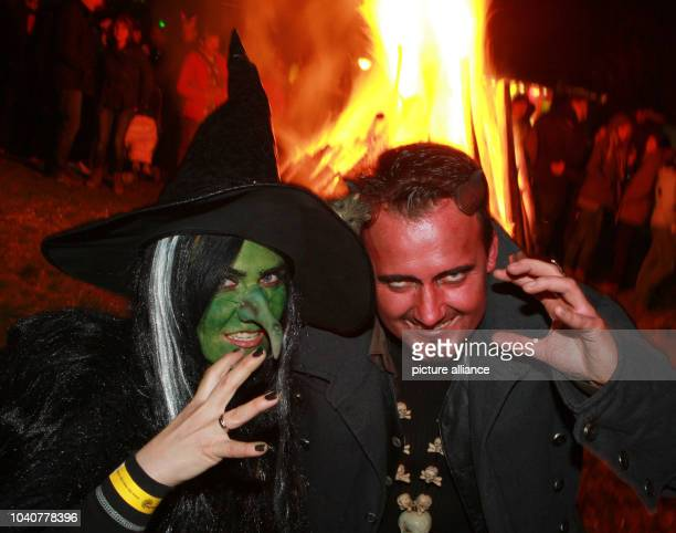 Two people dressed as witch and devil celebrate Walpurgis Night at the castle of Wernigerodee Germany 30 April 2013 Photo MATTHIAS BEIN | usage...