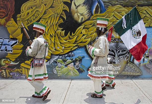 Two people dressed in period costumes arrive for the reenactment of the Batlle of Puebla to commemorate the defeat over the French Army in Mexico...