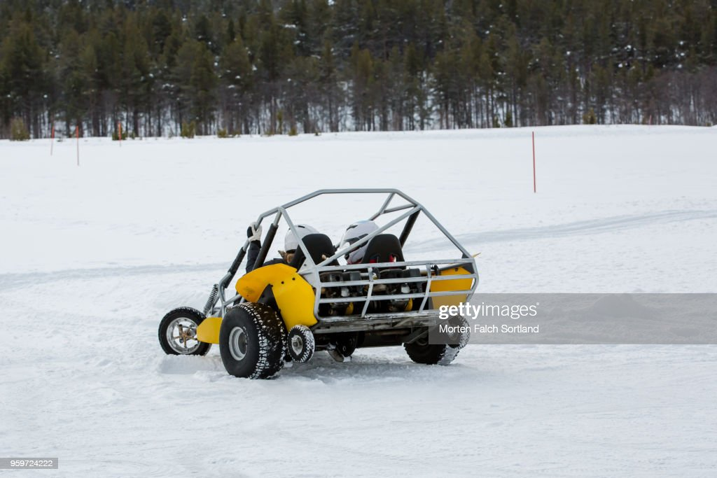 Two People Drive a Snow Buggy Around an Obstacle Course in Rural Norway, Wintertime : Stock-Foto