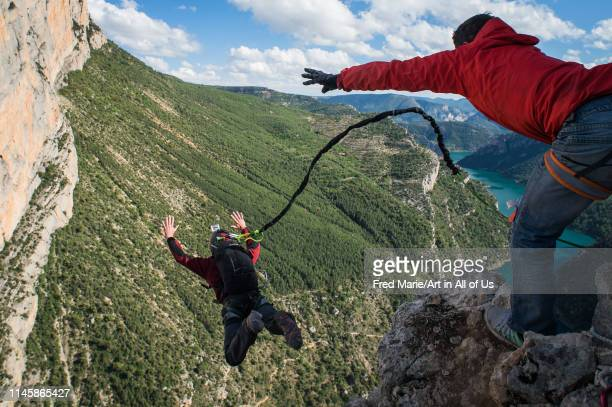 Two people during a rope jump session in the mountains Huesca Puente de montañana Spain on May 21 2014 in Puente De Montañana Spain