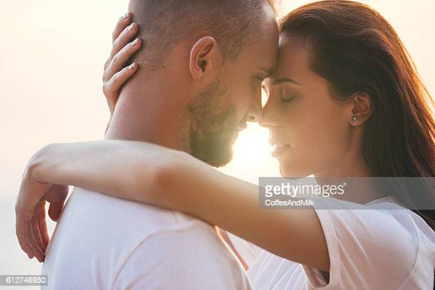 Two people embracing each other