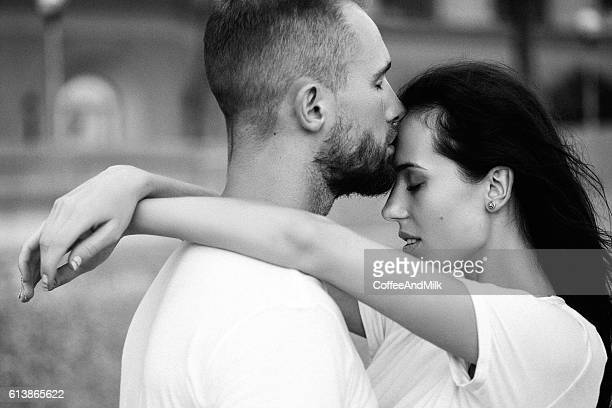 two people embracing each other - black and white sensual couples stock photos and pictures