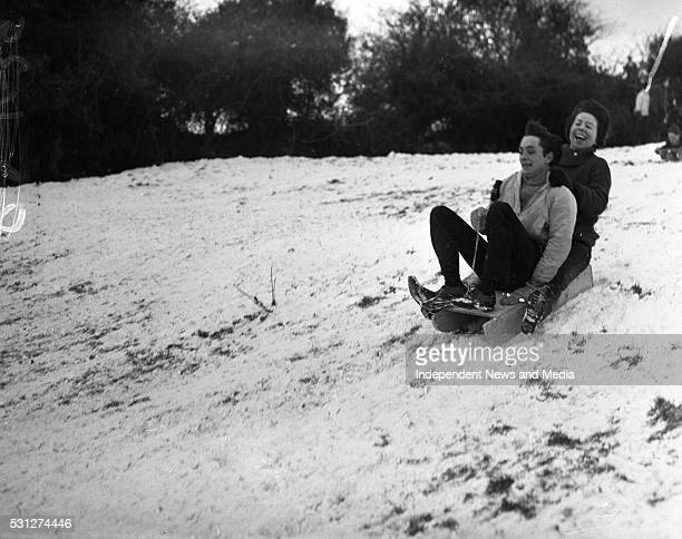 Two people enjoying the snow