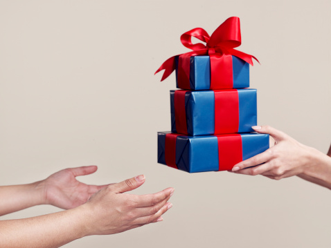 Two people exchanging gifts, close-up of hands - gettyimageskorea