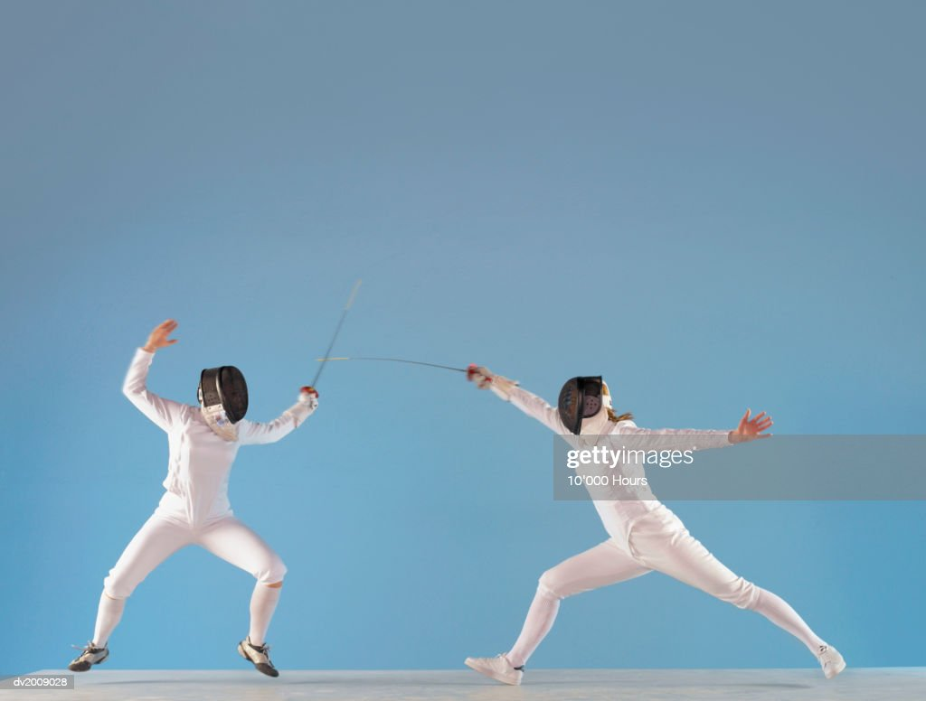 Two People Fencing : Stock Photo