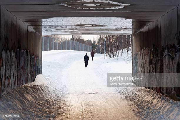 two people framed by an underpass - jyväskylä stock photos and pictures