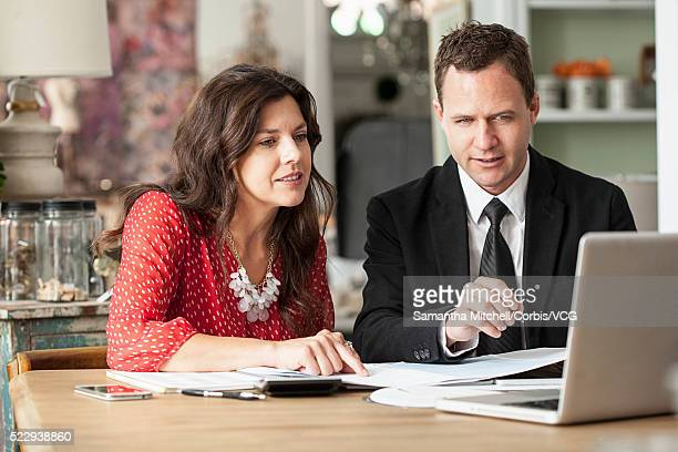 Two people having business meeting and looking at laptop