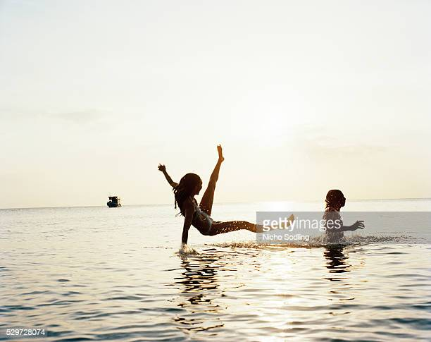 Two people having fun in the ocean Thailand