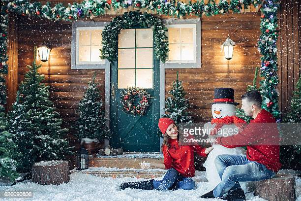 Two people having fun on the porch of their home