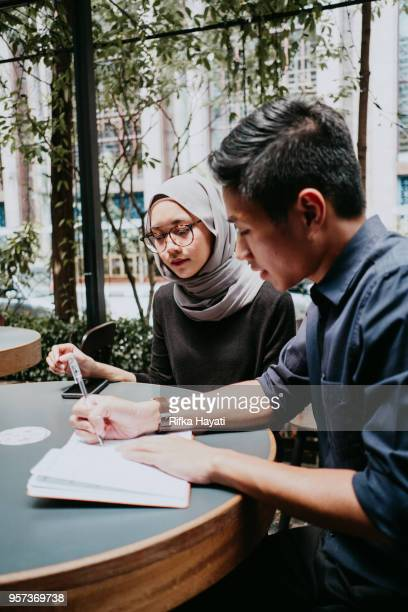 two people having serious discussion - rifka hayati stock pictures, royalty-free photos & images