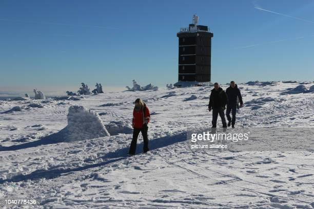 Two people hike on Brocken mountain near Schierke Germany 21 January 2017 Visitors of the Harz region can expect sunshine and a lot of snow Photo...