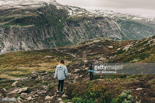 Two people hiking in mountains