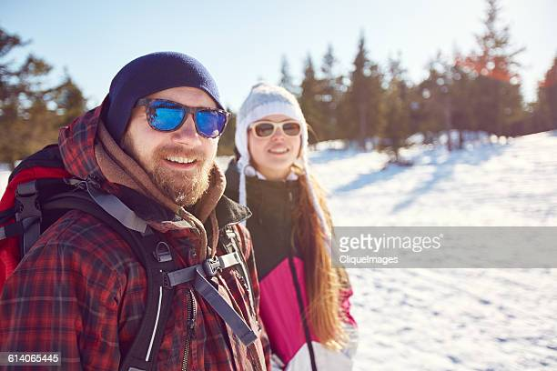 two people hiking in winter - cliqueimages stock pictures, royalty-free photos & images