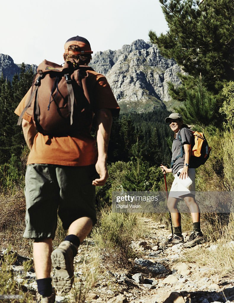 Two People Hiking on a Mountain Path : Stock Photo