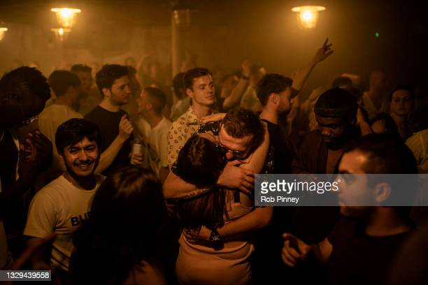 Two people hug in the middle of the dancefloor at Egg London nightclub in the early hours of July 19, 2021 in London, England. As of 12:01 on Monday,...