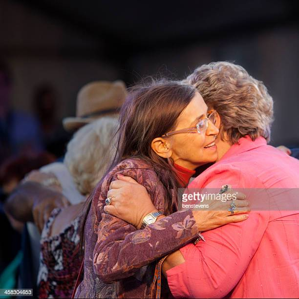 two people hugging - adelaide festival stock pictures, royalty-free photos & images