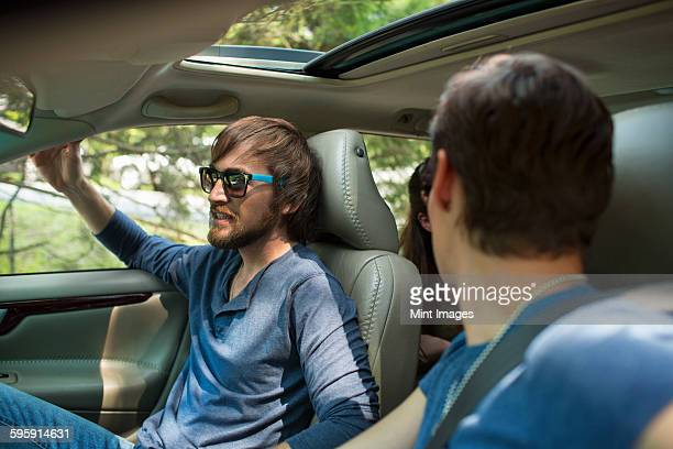 two people in a car, passenger and driver.  - friends inside car stock photos and pictures