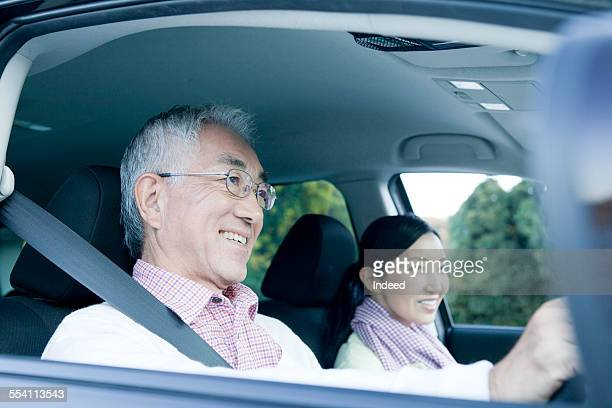 two people in a car