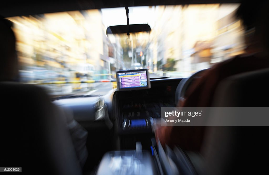 Two People in a Taxi With GPS, Shibuya, Tokyo, Japan : Stock Photo