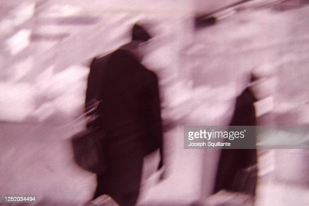 two people in motion off to work - joseph squillante stock pictures, royalty-free photos & images