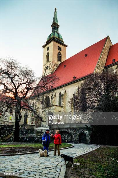 Two people (local residents of Bratislava), in the center of the old city, stand and talk