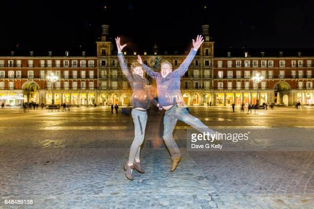 Two People Jumping, Plaza Mayor at Night, Madrid