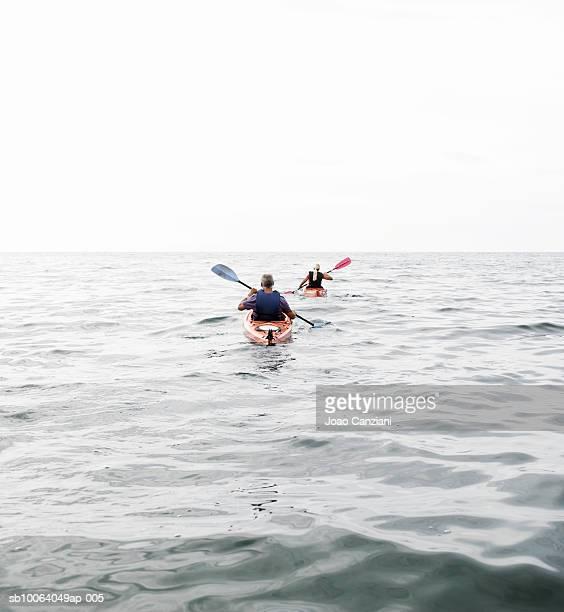 Two people kayaking in sea