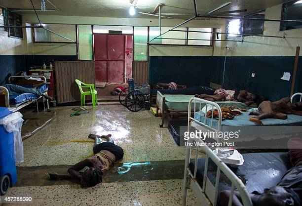 Two people lay dead on the floor inside the critical ward of the Redemption Hospital which has become a transfer and holding center to intake Ebola...