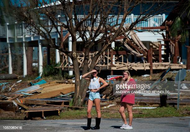 Two people look at destroyed beach houses in Port St Joe beach Florida on October 13 three days after hurricane Michael hit the area Since Hurricane...