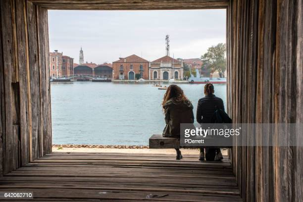 two people look out at the redevelopment of arsenale,venice - venetian arsenal stock pictures, royalty-free photos & images
