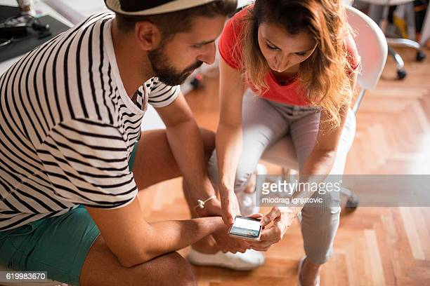 Two people looking at the phone