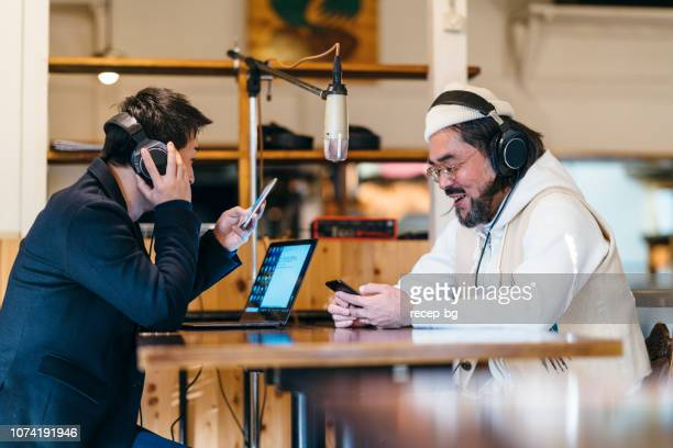 two people making talkshow for radio - radio broadcasting stock pictures, royalty-free photos & images
