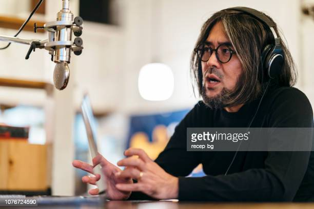 two people making talkshow for radio - sound recording equipment stock pictures, royalty-free photos & images