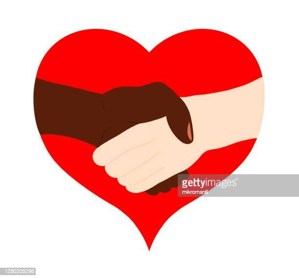 two people of different races, white and black, shaking hands - social justice concept stock pictures, royalty-free photos & images