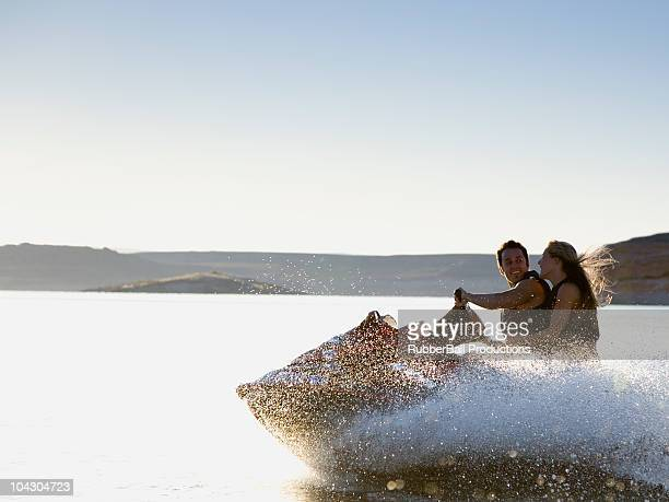 two people on a waverunner during summer vacation at lake powell