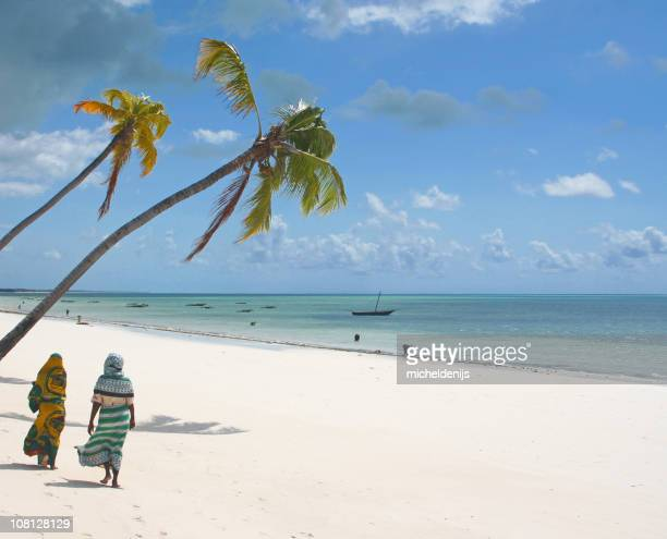 two people on an african beach - zanzibar island stock photos and pictures