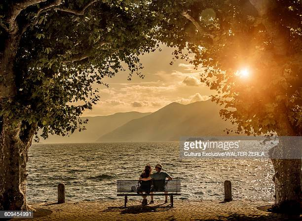 Two people on bench, Lake Maggiore, Ascona, Switzerland