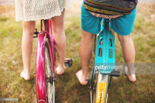 two people on bikes, high angle - close to stock pictures, royalty-free photos & images