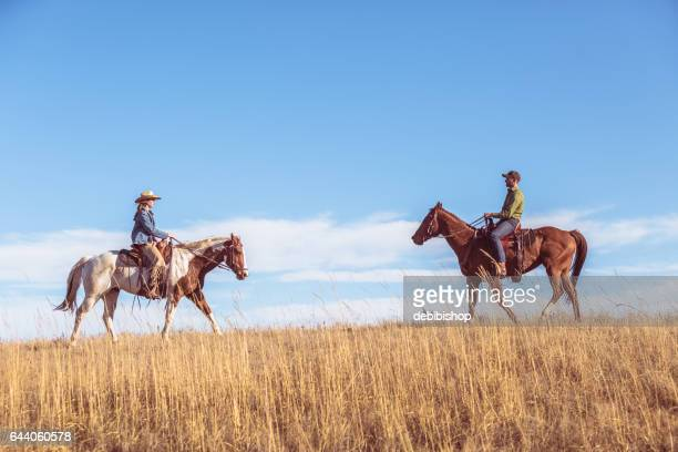 two people on horseback riding toward each other - istock photo stock pictures, royalty-free photos & images