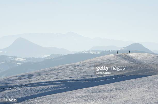 Two people on snowy hill