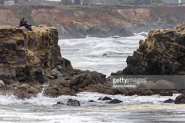 Two people on the coastline near Santa Cruz, California