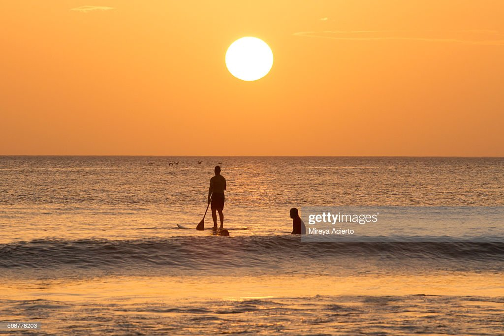 Two people paddle boarding : Stock Photo